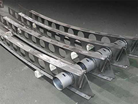 Rolled progressive arch castellated steel beam segment/weldment assembly